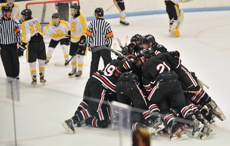 Lakeville North celebrates after beating Burnsville in overtime. Photo by Katherine Matthews