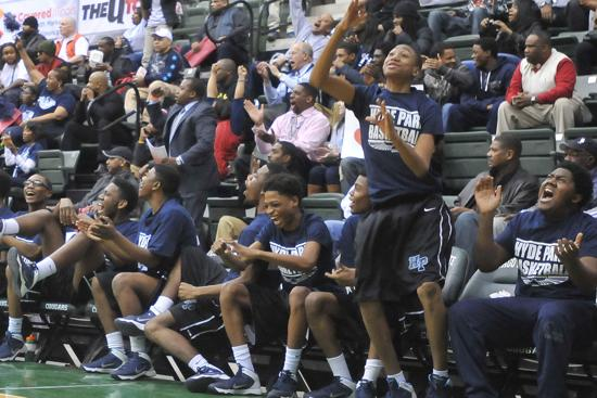 Hyde Park's bench cheers after tying the game in the in the fourth quarter.