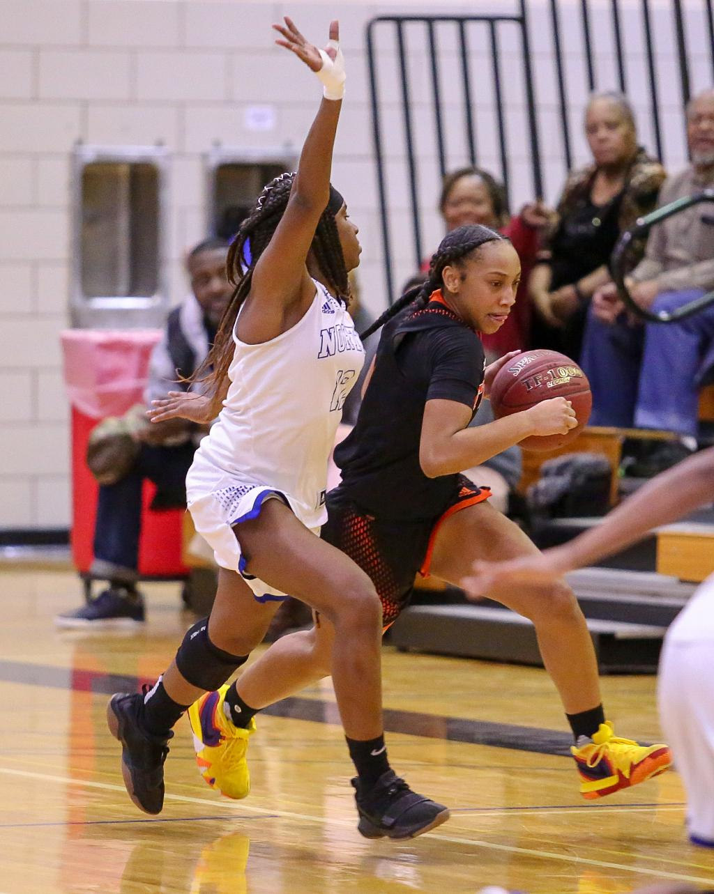 Jade Hill brings the ball up court past defender Tiffany McNeill (12). Hill led all scorers with 22 points helping the Tigers hang on to defeat the Polars 62-59 on Tuesday night. Photo by Cheryl Myers, SportsEngine