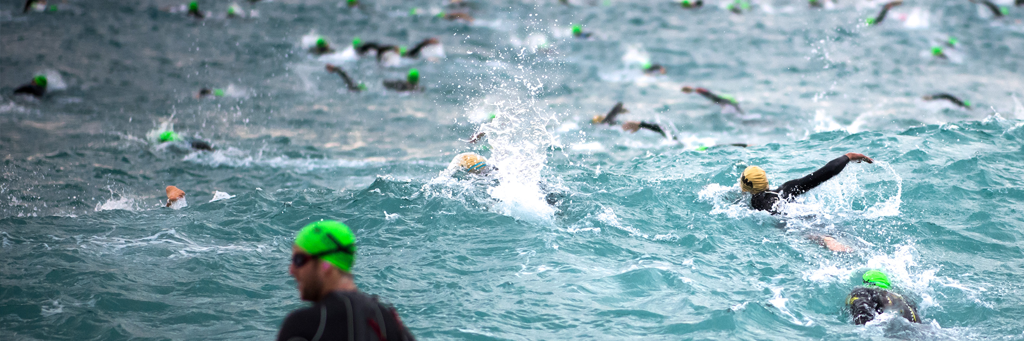 IRONMAN Barcelona athletes swimming in the Mediterranean Sea in Calella