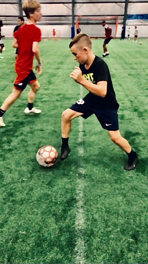 Youth summer standout, Niall McClintock, dribbles the ball at Go2Goal training session