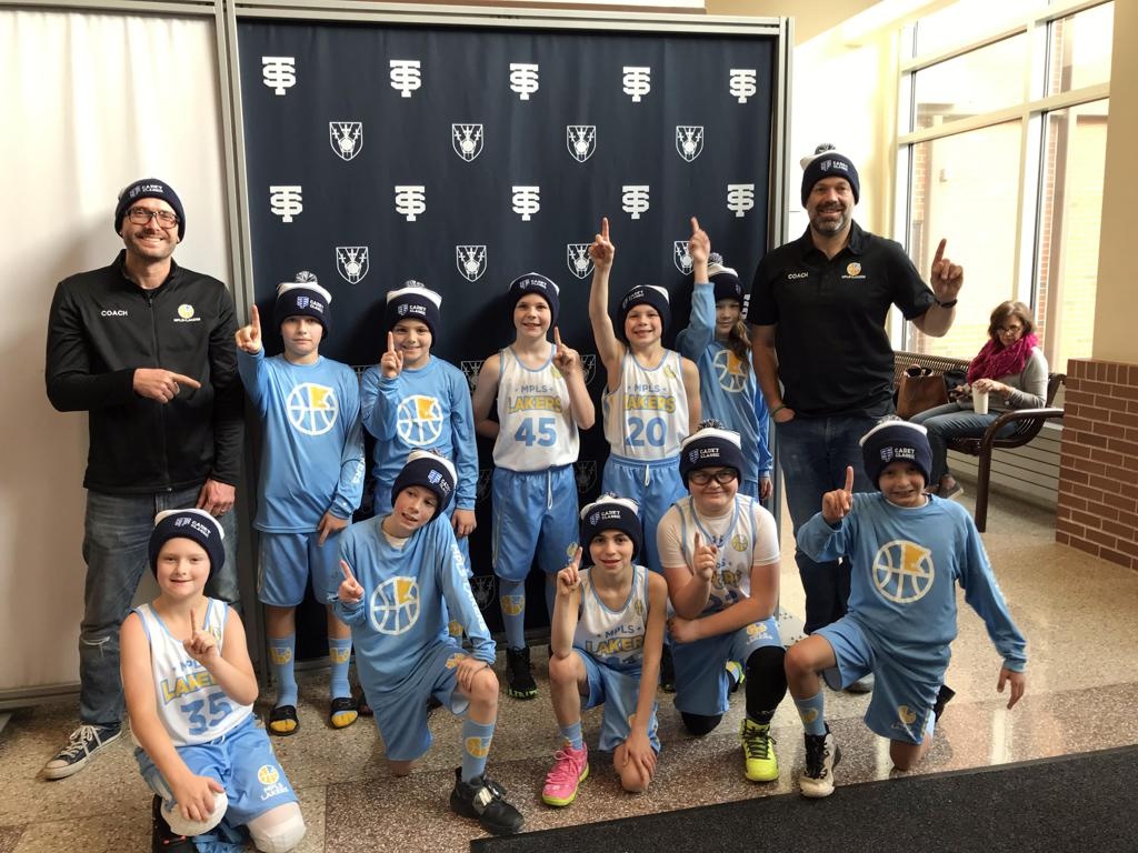 Minneapolis Lakers Boys 4th Grade Blue pose with their Hats after becoming the Champions at the Cadet Classic tournament in Mendota Heights, MN