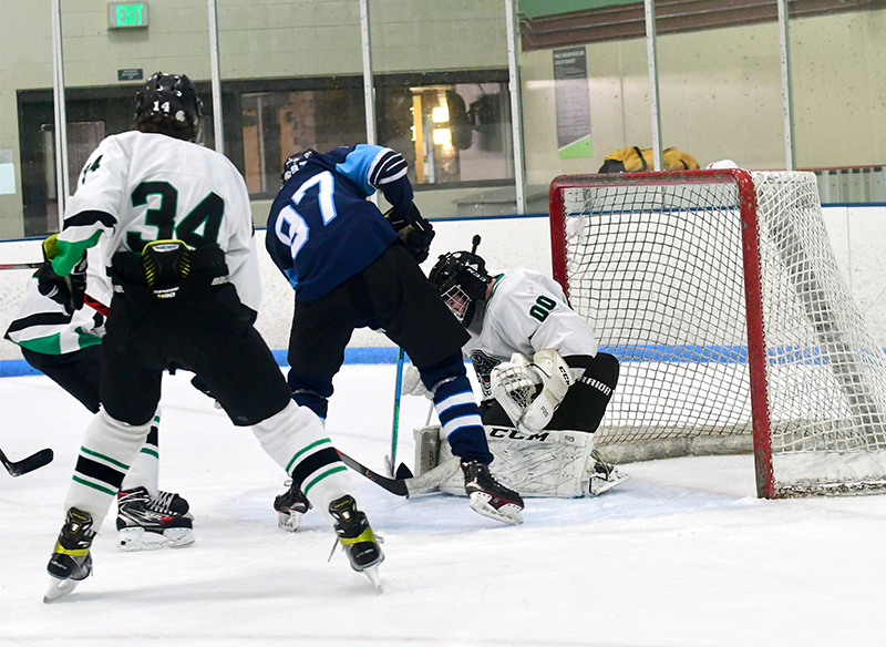 Chaise Coisman (97) from Ralston Valley fights to get off a shot on Fossil Ridge goalie Kaleb Choury Saturday. Coisman had two goals and an assist in his team's 4-2 triumph. Photo by Steven Robinson, SportsEngine