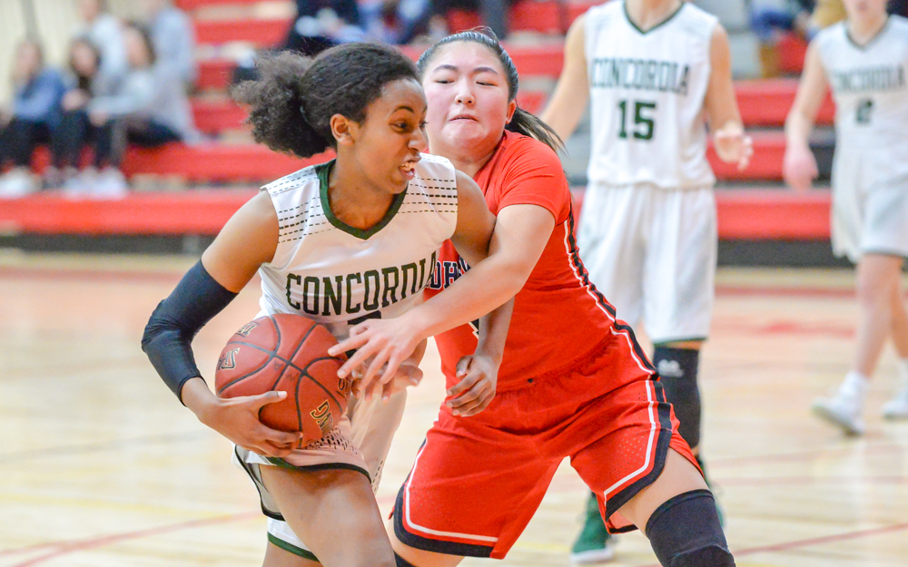 Concordia's sophomore Ivane Tensaie fights her way past Minnehaha Academy's Tanna Gallo. Tensaie scored 20 points in the game but the Beacons lost to the Redhawks 74-57.  Photo by Earl J. Ebensteiner, SportsEngine