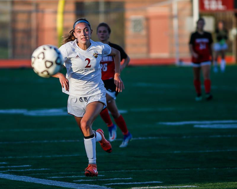 Coming off back-to-back wins, Lauren Bredensteiner and the Crimson look to stay hot against the Cougars, who are coming off a big win over Andover. Photo by Mark Hvidsten, SportsEngine