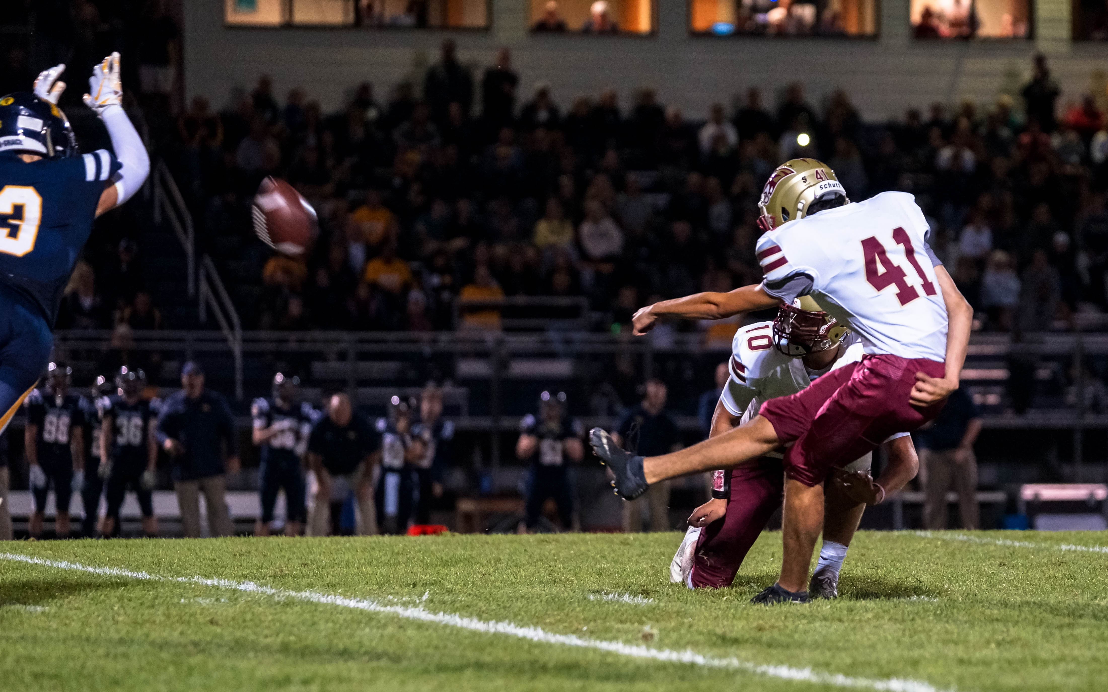 Lakeville South kicker John Olson (41) with the game-winning kick with just 13.5 seconds left to play against Totino-Grace on Thursday night. The Cougars beat the Eagles 13-10. Photo by Korey McDermott, SportsEngine