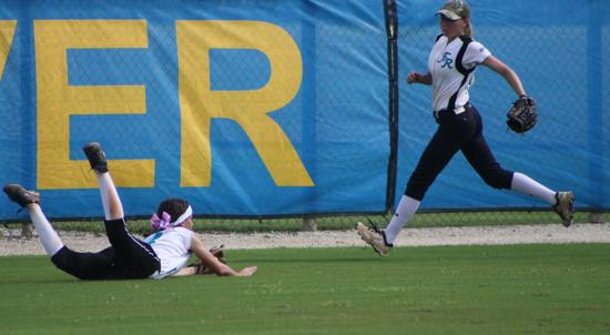 Megan G. successfully diving for a ball in the outfield at Indian River State College