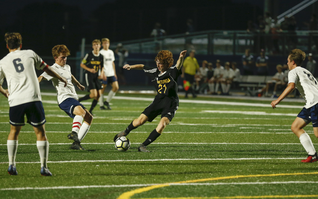 Waconia's Michael Bortz gets a shot off as three Orono defenders converge on the play. The Wildcats fell to the Spartans 2-0 at Waconia High School Tuesday night. Photo by Jeff Lawler, SportsEngine