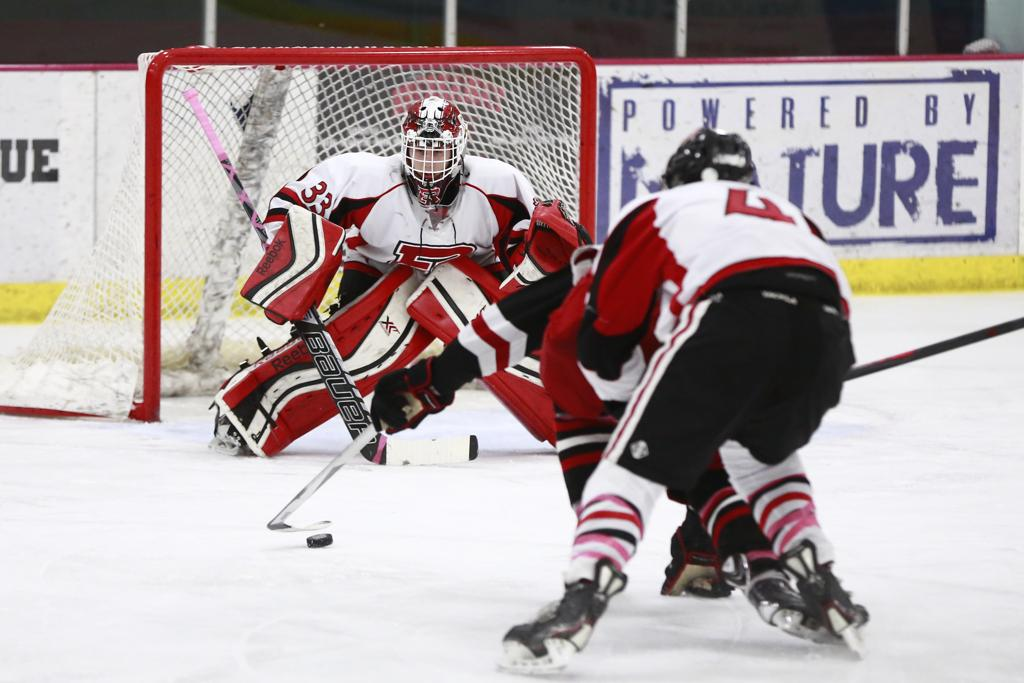 January 31; Elk River, MN - Elk River Goalie (33) prepares to stop a goal against Duluth East - Photo by Chris Juhn
