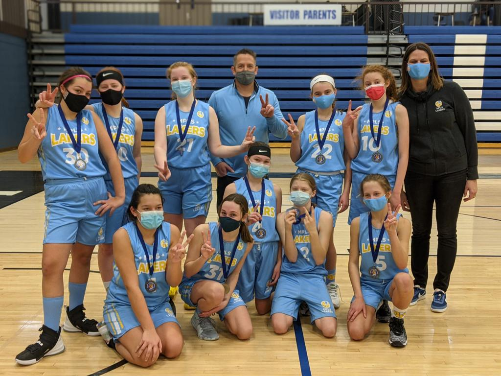 Mpls Lakers Youth Traveling Basketball Program Inc Girls 7th Grade Gold pose after placing 2nd at the Woodbury Royal Rumble tournament in Woodbury, MN