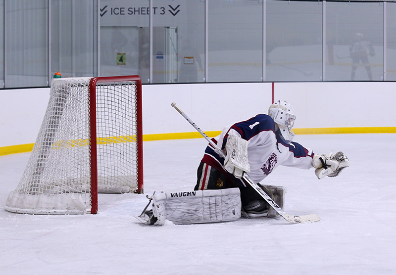 Zachary Janda makes one of his 46 saves for Cherokee Trail Friday night. Janda's team defeated Mountain Ice 6-2 in Littleton. Photo by Katie Hinkle, SportsEngine