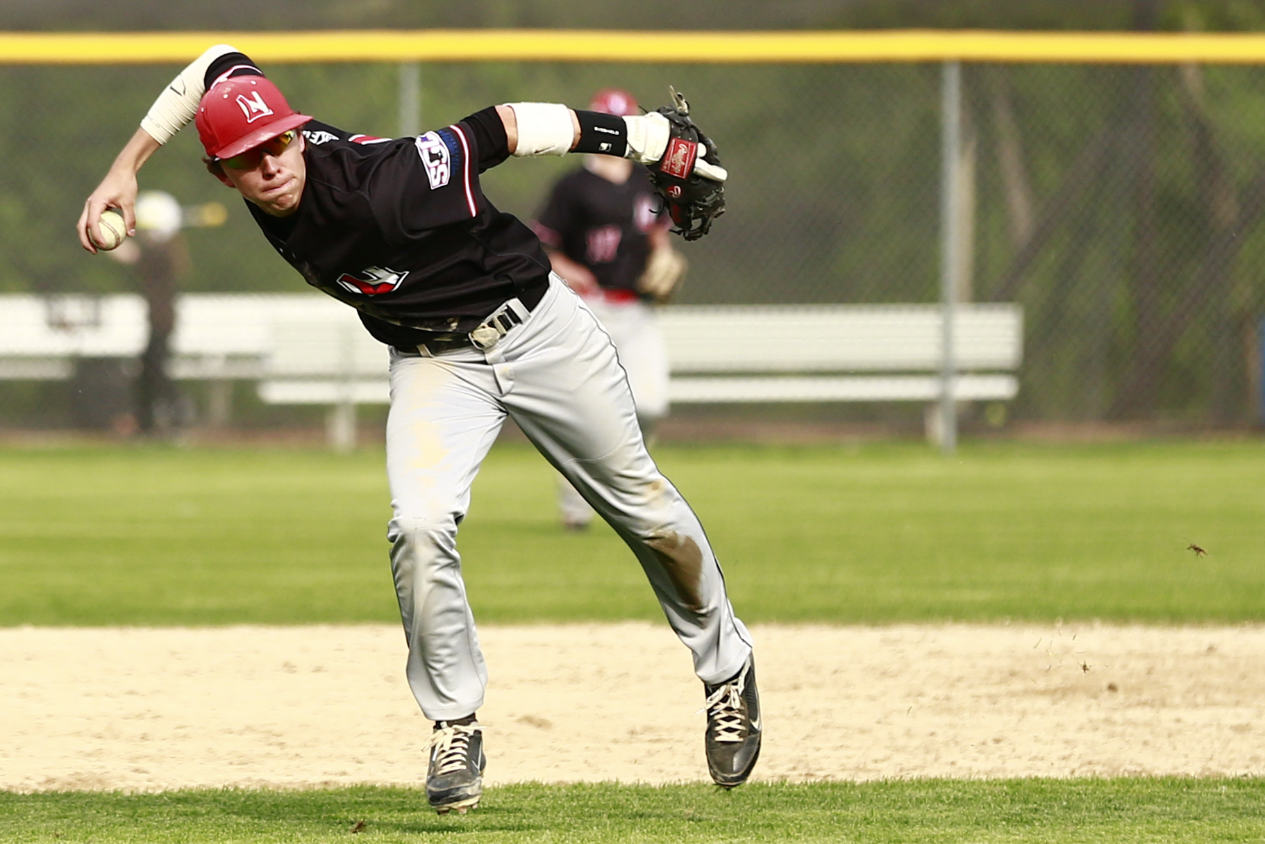 Angelo Altavilla (7) of Lakeville North throwing the inning ending out to first base in the 6th inning. Angelo Altavilla started off the game by hitting a 3 run homer and helped his team secure a 12 to 6 victory against Apple Valley. Photo by Chris Juhn