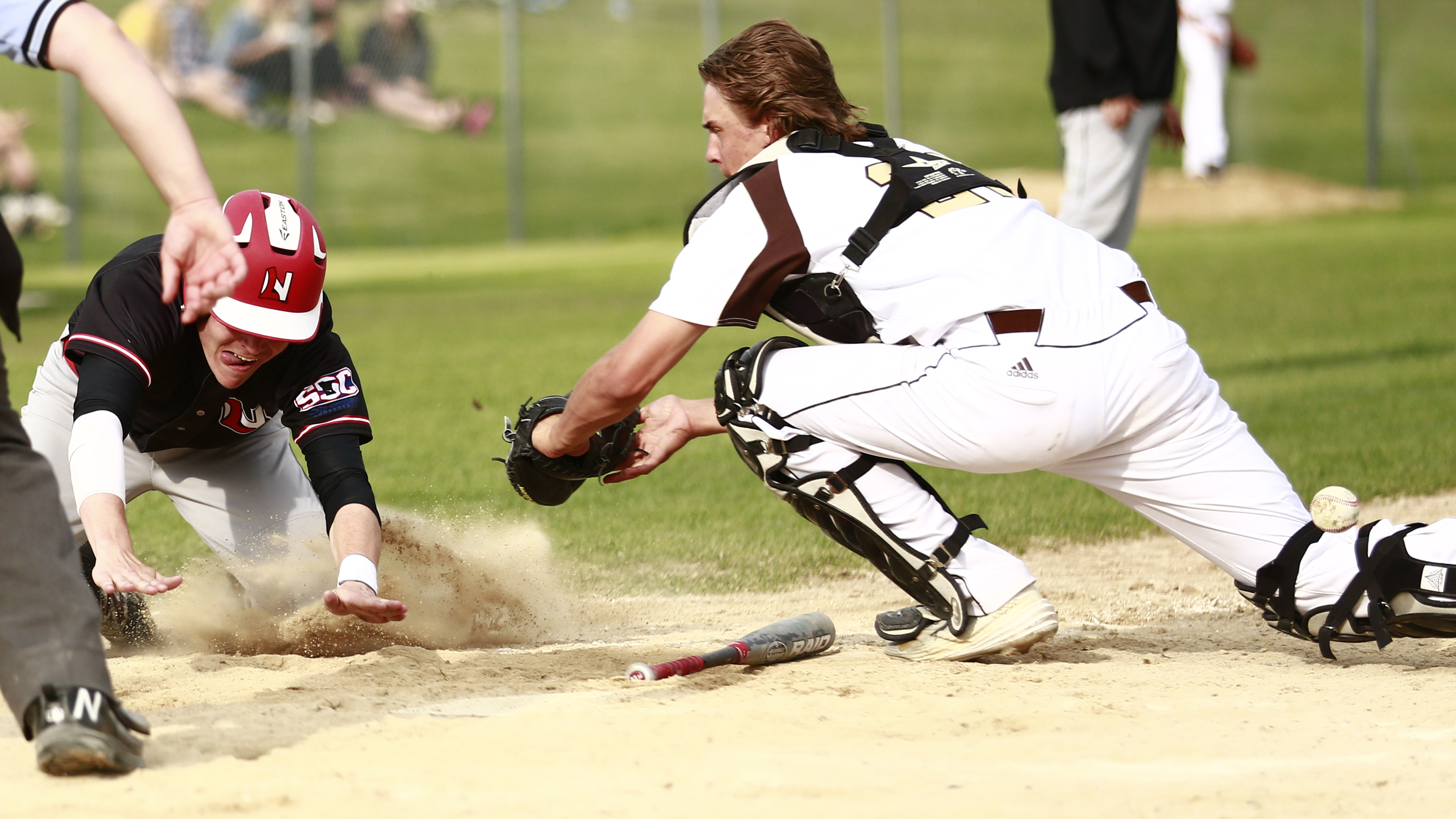 A close call ended in a run scored by Lakeville North. Photo by Chris Juhn
