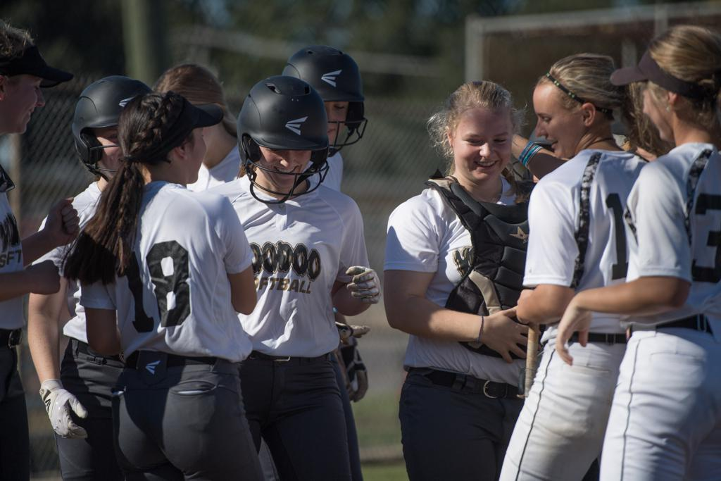 Rachel Rhinehart is greeted after hitting a home run