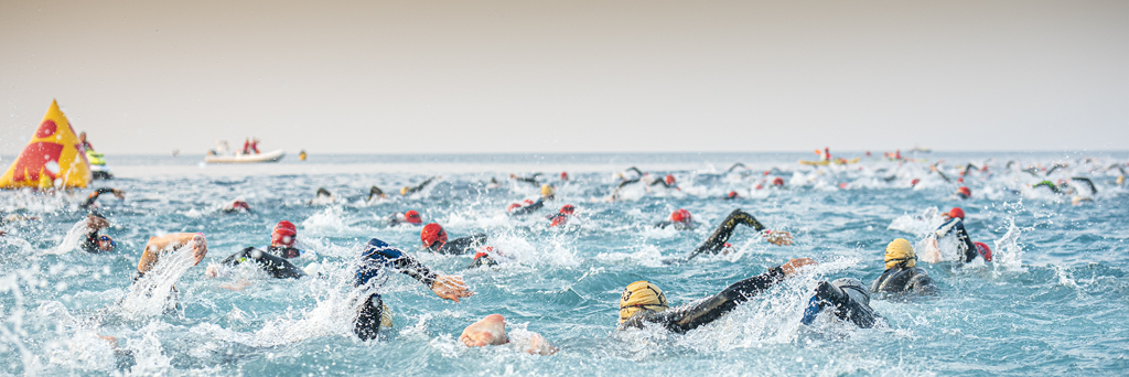 Swimmers participating in IRONMAN race