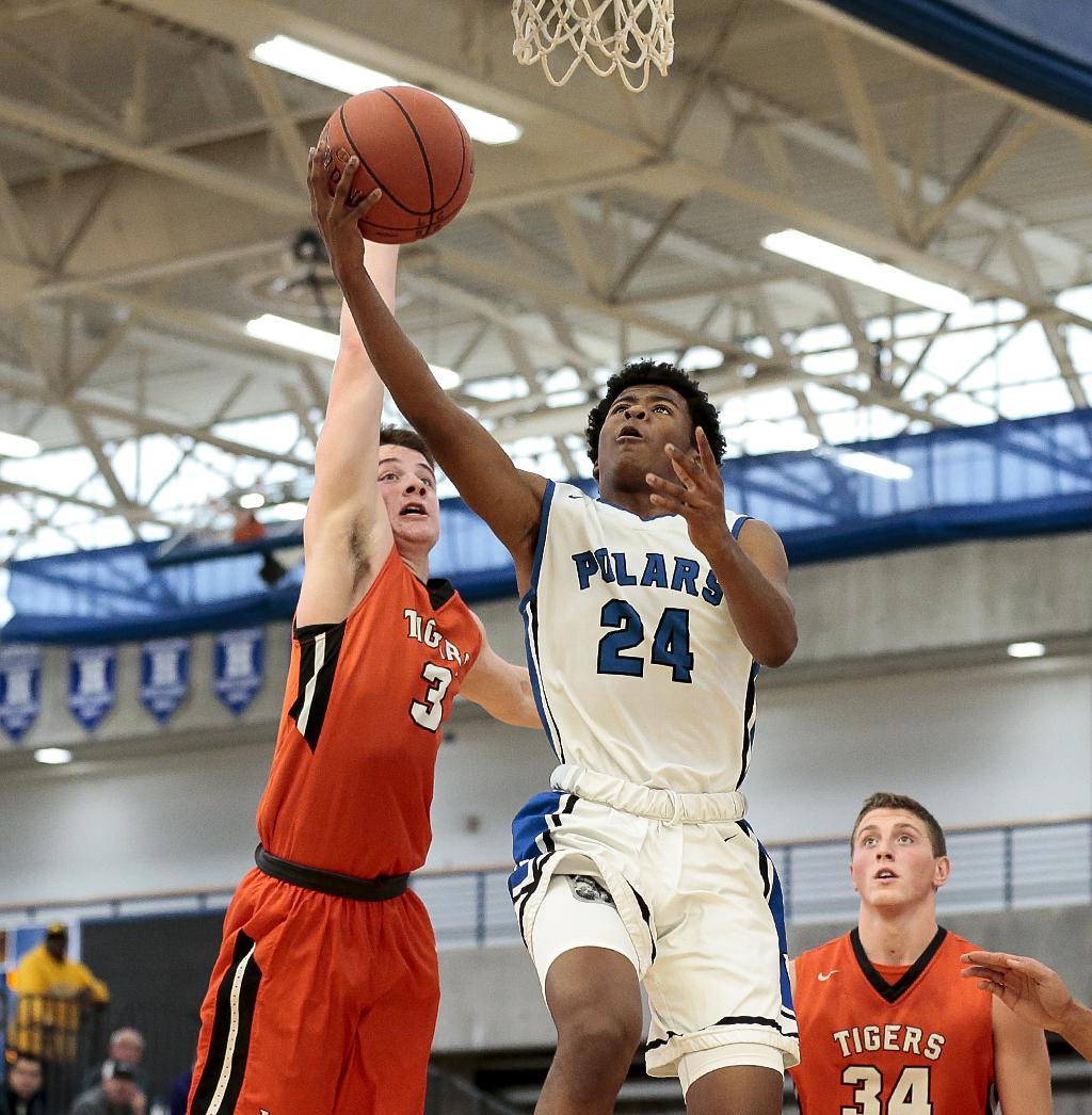 Sophomore point guard Willie Wilson (24) scored 19 points for the Polars. Minneapolis North, ranked No.4 in the Class 2A by Minnesota Basketball News lost to No.2, 2A Lake City by a score of 65-54. Photo by Cheryl A. Myers, SportsEngine