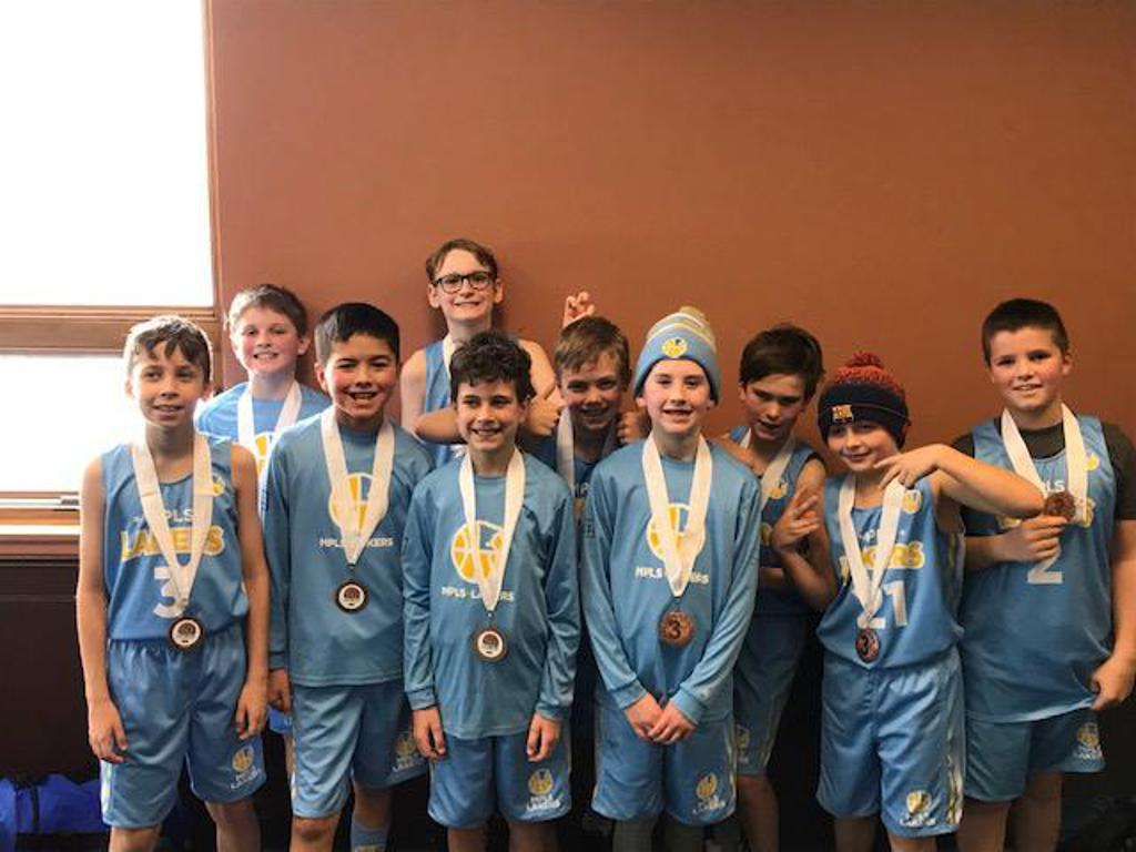 Minneapolis Lakers Boys 4th Grade Blue pose with their hardware after taking 3rd Place at Anoka Ramsey Tornado Shootout in Anoka, MN