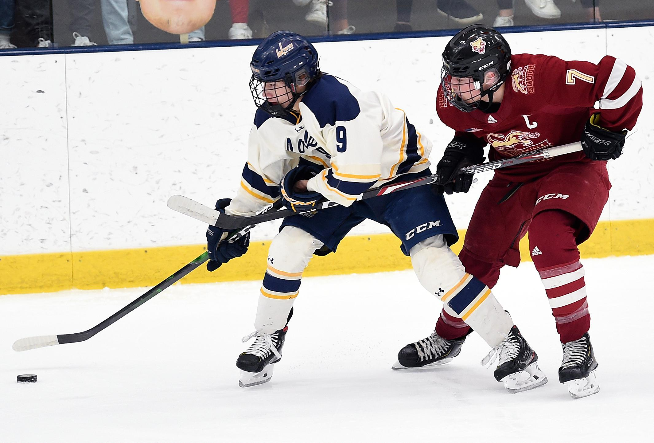 Prior Lake's Alex Bump, left, tries to shake loose from Lakeville South's Cade Ahrenholz during Saturday's game in Prior Lake. Photo by Loren Nelson, LegacyHockeyPhotography.com