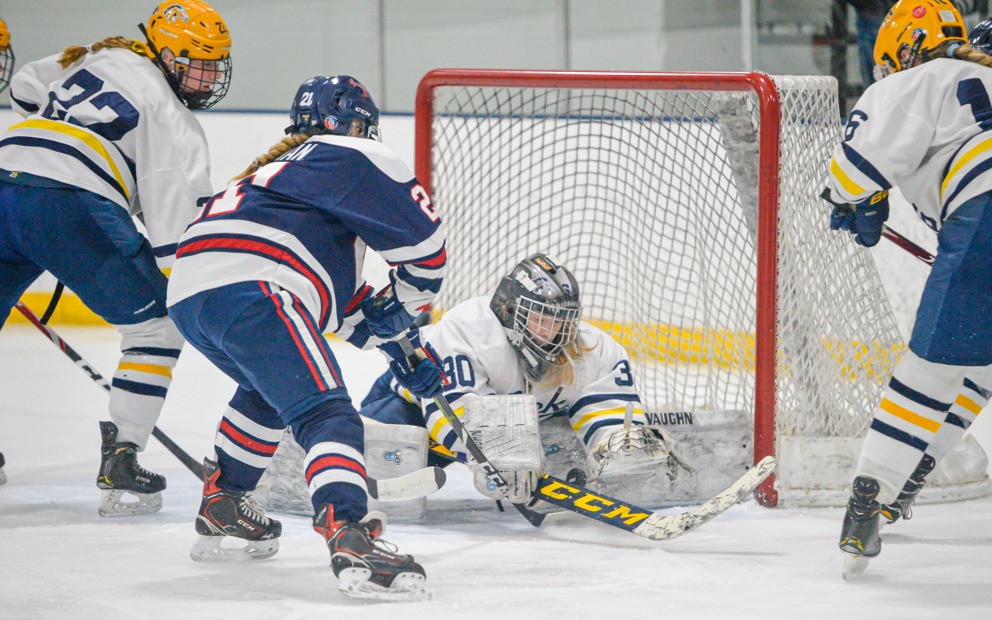 Orono's Kaeli Koopman attempts to force the puck into the net Wednesday night in the Class 1A, Section 5 final. The Spartans lost to the Mustangs 6-2. Photo by Earl J. Ebensteiner, SportsEngine