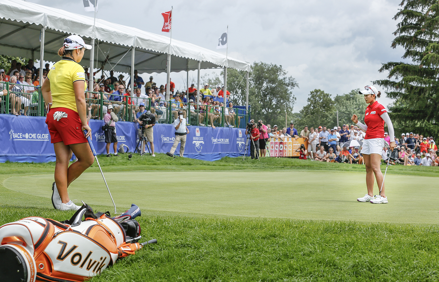 Ha Na Jang, left, watches as Chella Choi pumps her fist after saving par on No. 18 to send them to a playoff in the final round of the LPGA Marathon Classic at Highland Meadows Golf Club. BLADE/ANDY MORRISON