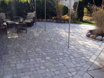 Brick Paver Patio Using A Variety Of Brick Sizes.