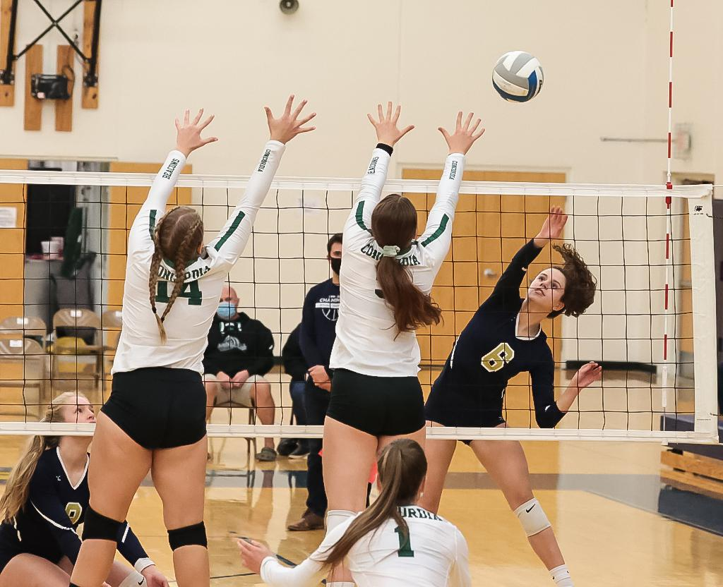 Sophomore outside hitter Kate Neau (6) sends the ball past Emma Revoir (14) and Brooke Weichbrodt (3). Neau had a team-high three kills for St. Croix Preparatory Academy in a 3-0 loss to Concordia Academy. Photo by Cheryl A. Myers, SportsEngine