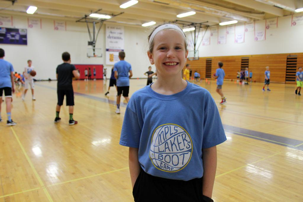 4th Grade girls wearing Boot Camp t-shirt smiling in the gym during training session