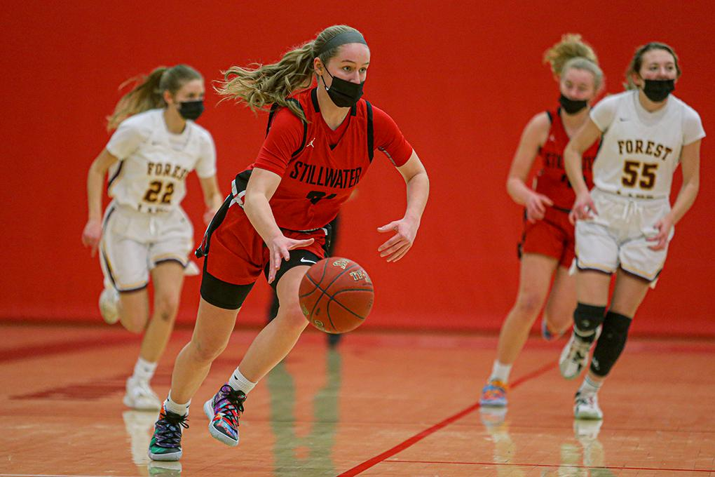 Stillwater's Amber Scalia (21) pushes the ball up the court following a Forest Lake turnover. Scalia scored 20 points in the Ponies' victory. Photo by Mark Hvidsten, SportsEngine