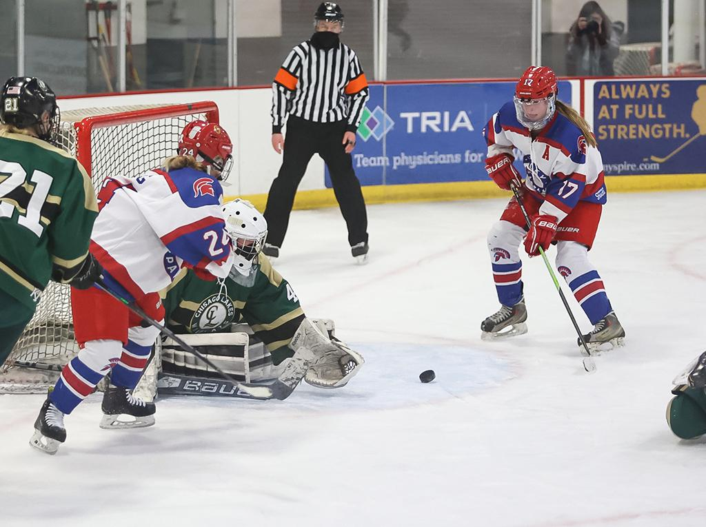 Kate Carlson (17) is left alone at the top of the crease and sends the loose puck past goaltender Anna Hanson. Carlson's goal brought Simley within one, with just under five minutes remaining in regulation. Photo by Cheryl A. Myers, SportsEngine