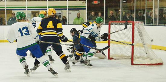 Blake's Karlie Lund (hidden behind Breck's No. 4 Grace Zumwinkle) scores in a game against Breck last year. The two teams face each other again on December 12. Photo credit: YHH.