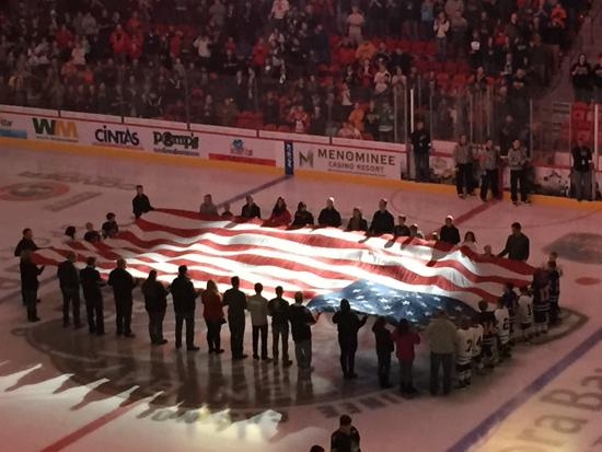 Squirt A's giving honors during the National Anthem at the Gambler's Military Night game.