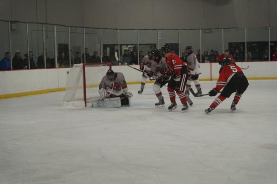 Lakeville North's Reed Smith scores in the Panthers' 6-5 loss to Stillwater. Credit: Peter Odney.