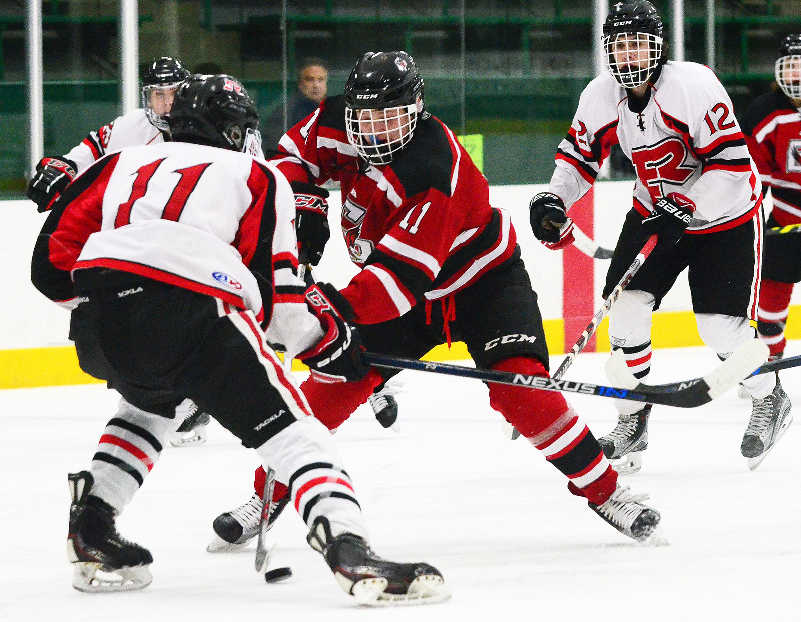 Eden Prairie's Casey Mittelstadt (11 in red) tallied a goal and an assist in leading the Eagles to a 5-2 victory over Elk River in opening round action of the 34th Annual Edina Classic at Braemar Ice Arena on Dec. 17th in Edina, MN. Photo by Nick Wosika
