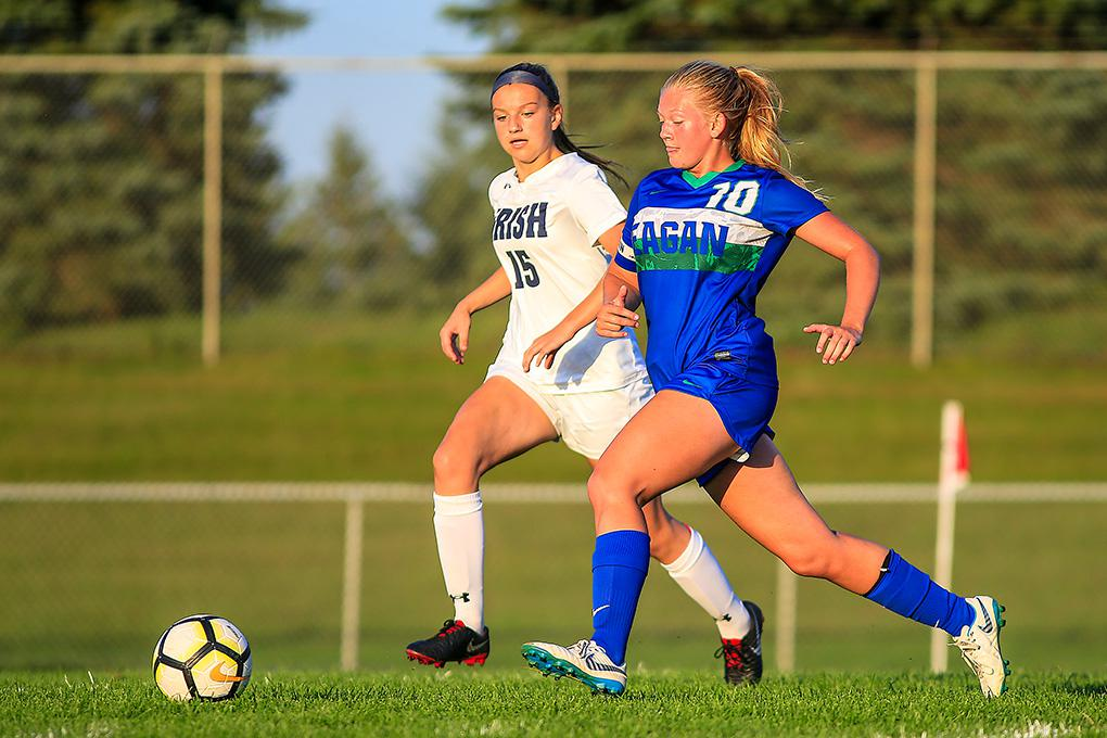 Eagan's Emily Cronkhite (10) tried to get past Rosemount defender Olivia Bohl late in the game. Photo by Mark Hvidsten, SportsEngine
