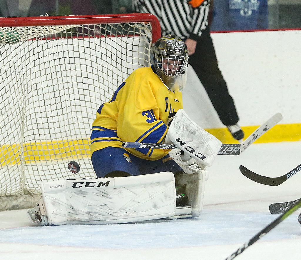 Sophomore goaltender Tyler McCarville deflects the puck to the corner with a pad save. McCarville tallied 39 saves in Hastings' 4-3 upset win over Eagan to win the South St. Paul Premier Tournament championship. Photo by Cheryl Myers, SportsEngine
