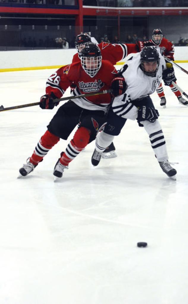 BHS'S Josh Lusby (13) AND Alexandria's Derek Berning (26) battle each other for the puck during a game Saturday in Bemidji. Maggi Stivers   Bemidji Pioneer