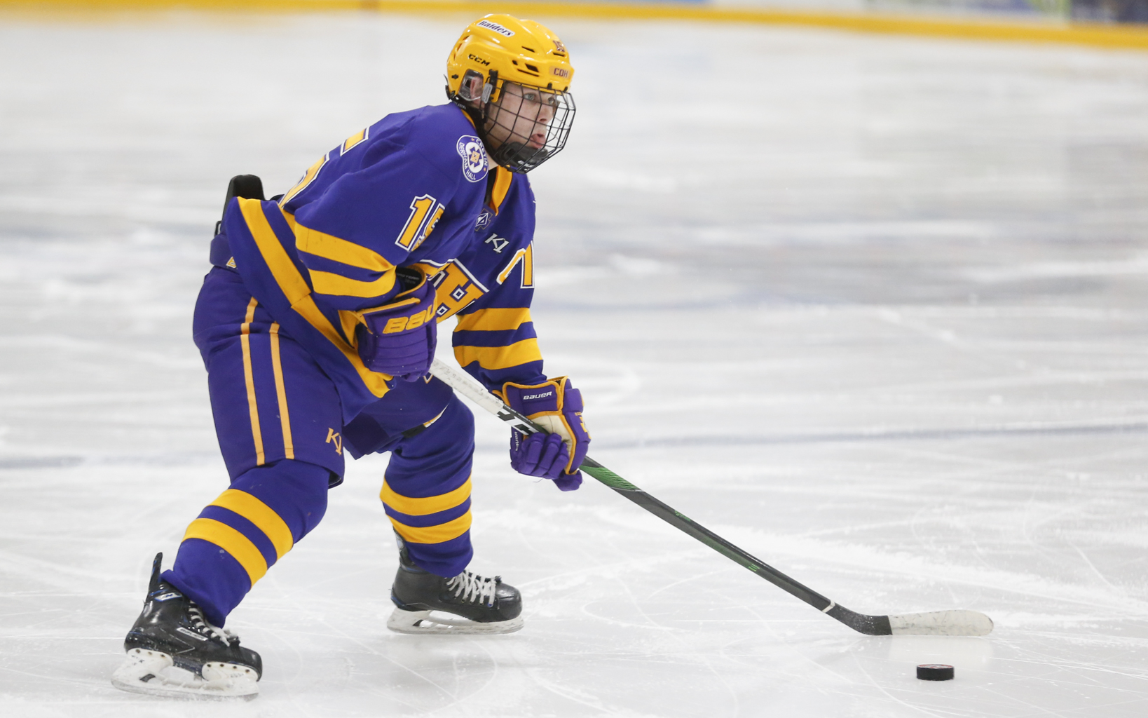 Cretin-Derham Hall's Matthew Gleason (15) looks for an open teammate on a power play opportunity against Stillwater Tuesday night. Gleason had two assists in the Raiders' 2-0 victory over the Ponies in Stillwater. Photo by Jeff Lawler, SportsEngine
