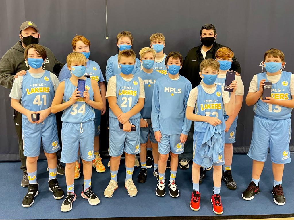 Mpls Lakers Youth Traveling Basketball Program Inc Boys 6th Grade White pose after placing 2nd at the Orono Spartan Classic tournament in Orono, MN