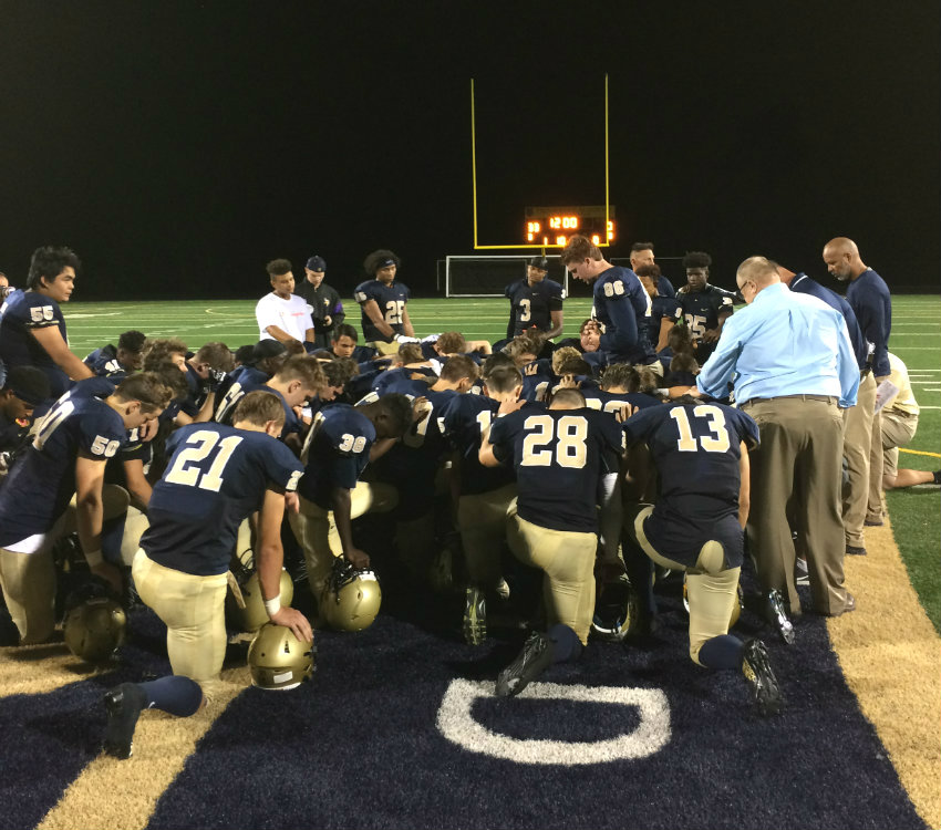 Providence Academy players meeting in a postgame huddle after defeating St. Croix Lutheran 33-0 at home Friday night. Photo by Luke Hanlon, SportsEngine