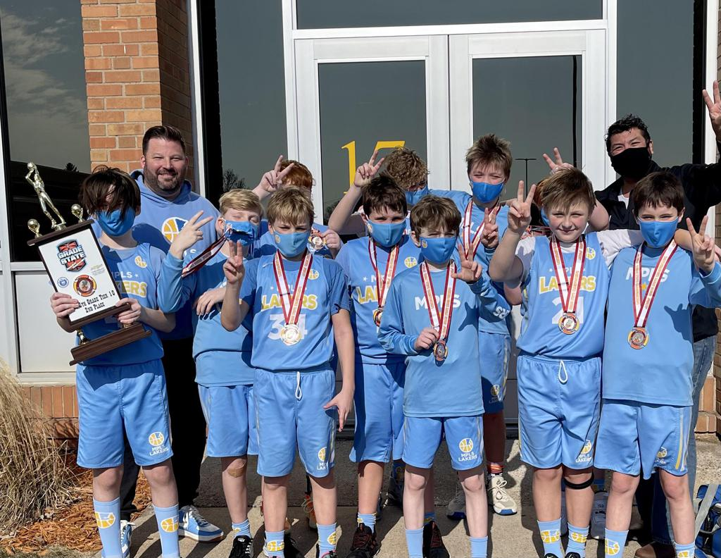 Mpls Lakers Youth Traveling Basketball Program Inc Boys 6th Grade Blue pose after winning the Consolation Bracket at MYAS Grade State year end tournament