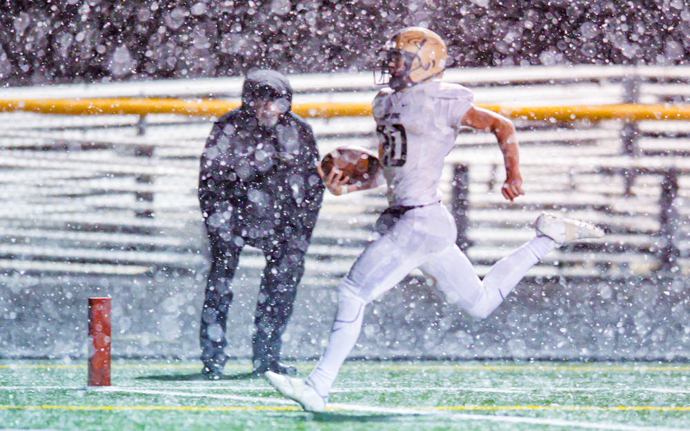 East Ridge senior quarterback Riley Larson capped a two-series comeback by scoring the game-winning touchdown Friday against Mounds View in a 41-40 victory. Photo by Earl J. Ebensteiner, SportsEngine