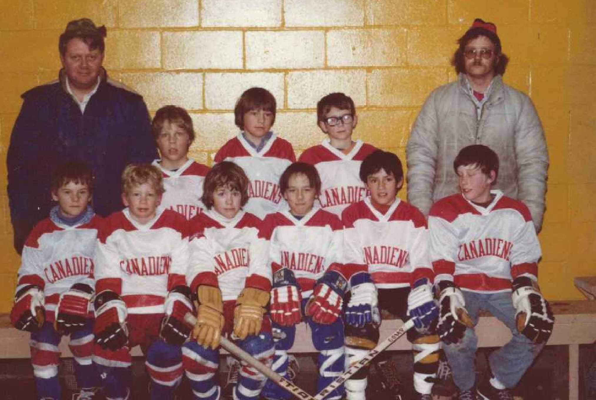 Warroad Mites team in 1978. Coaches are Frank Marvin (L) and Waag Erickson (R). Players, front row (L to R): Dana Estling, Dan Marvin, Chad Erickson, Joe Biondi, Todd Powassin, Mark Dahlberg. Back row (L to R): Keith Corneliusen, Mark Janzen,