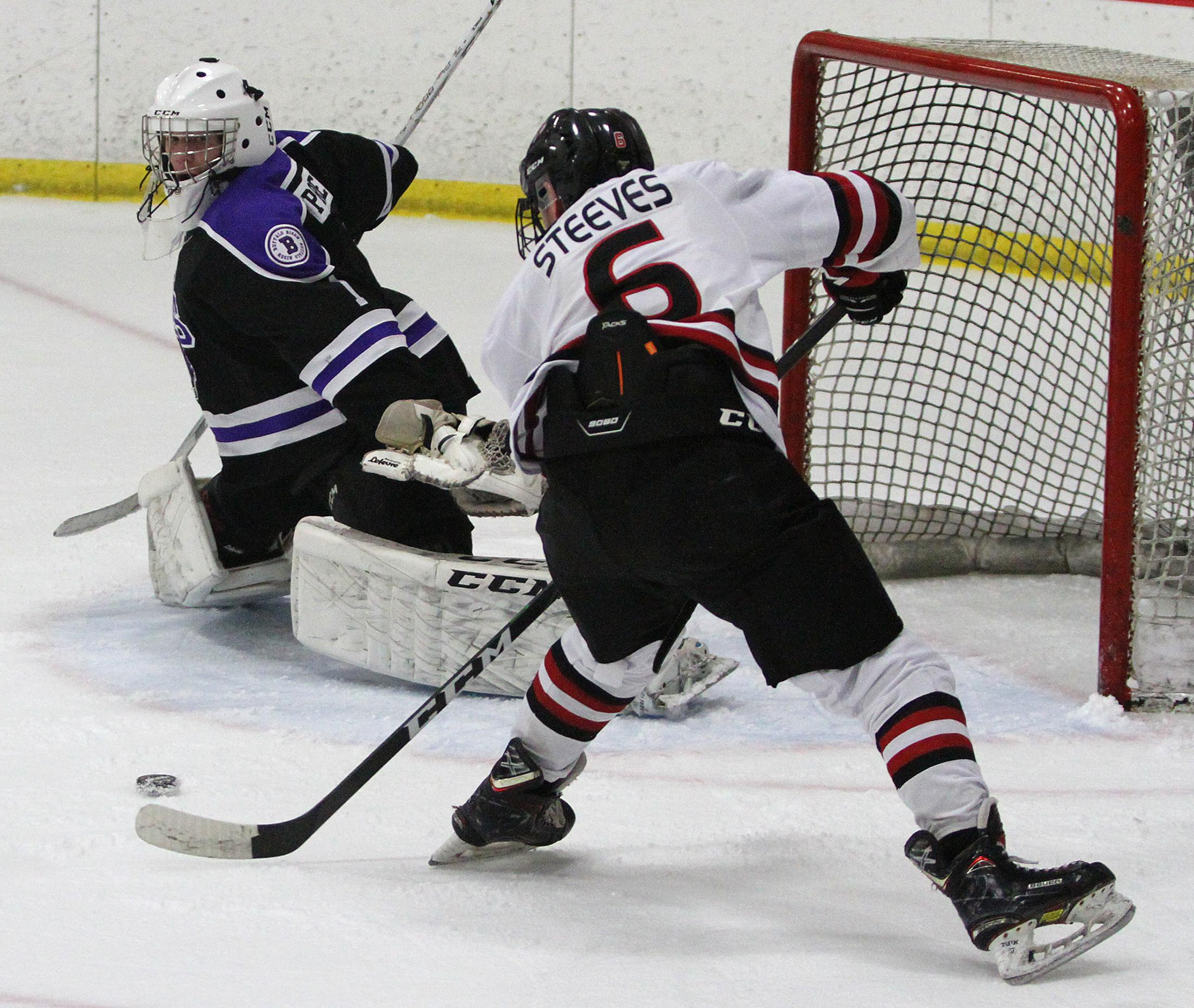 Eden Prairie senior forward Ben Steeves buries a first-period goal en route to a hat trick in Thursday's 9-1 victory over Buffalo. Photo by Drew Herron, SportsEngine