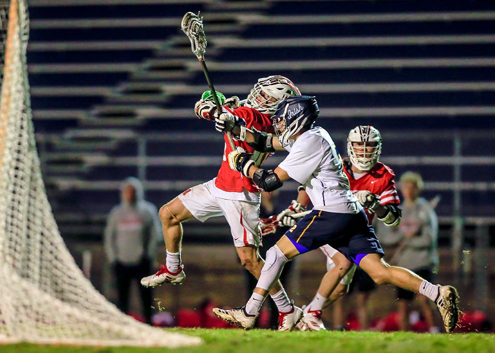 Keaton Mohs fired a shot over Rosemount defender Evan Geiwitz that put Lakeville North ahead 11-10 in the fourth quarter. The Panthers didn't give up the lead and won 14-11. Photo by Mark Hvidsten, SportsEngine