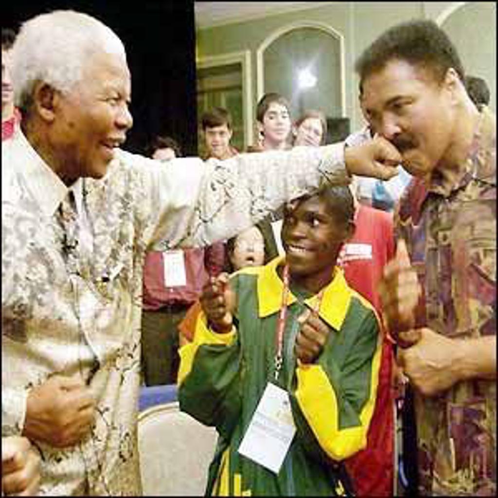 President Mandela Jabs Muhammad Ali