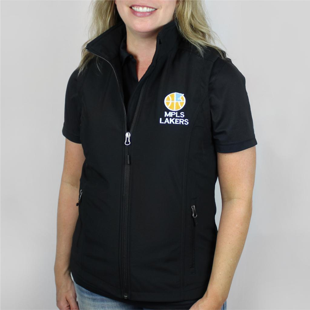 Attractive woman wearing Vest with embroidered logo