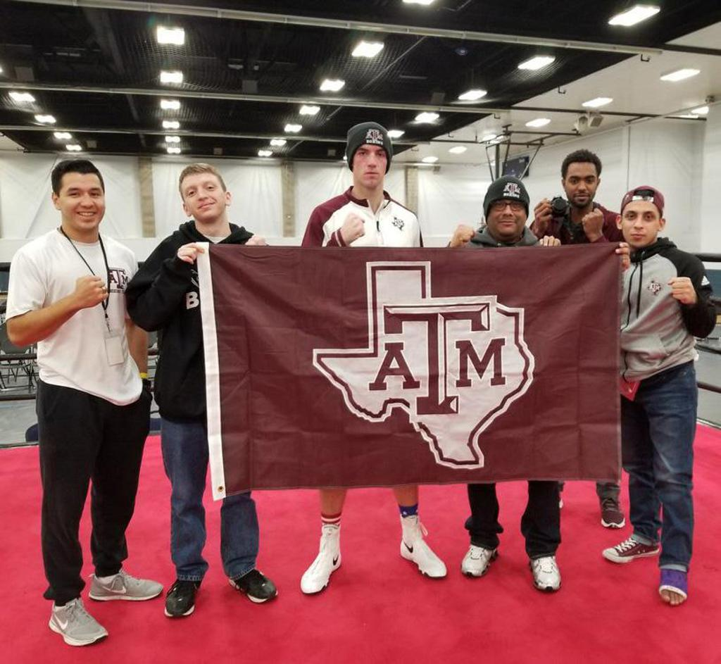 Texas A&M Boxing Club with flag