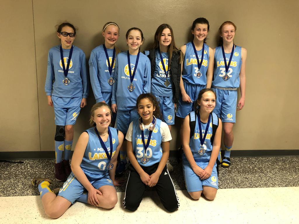 Minneapolis Lakers Girls 7th Grade Gold pose with their hardware after taking 2nd Place at Woodbury Royal Rumble