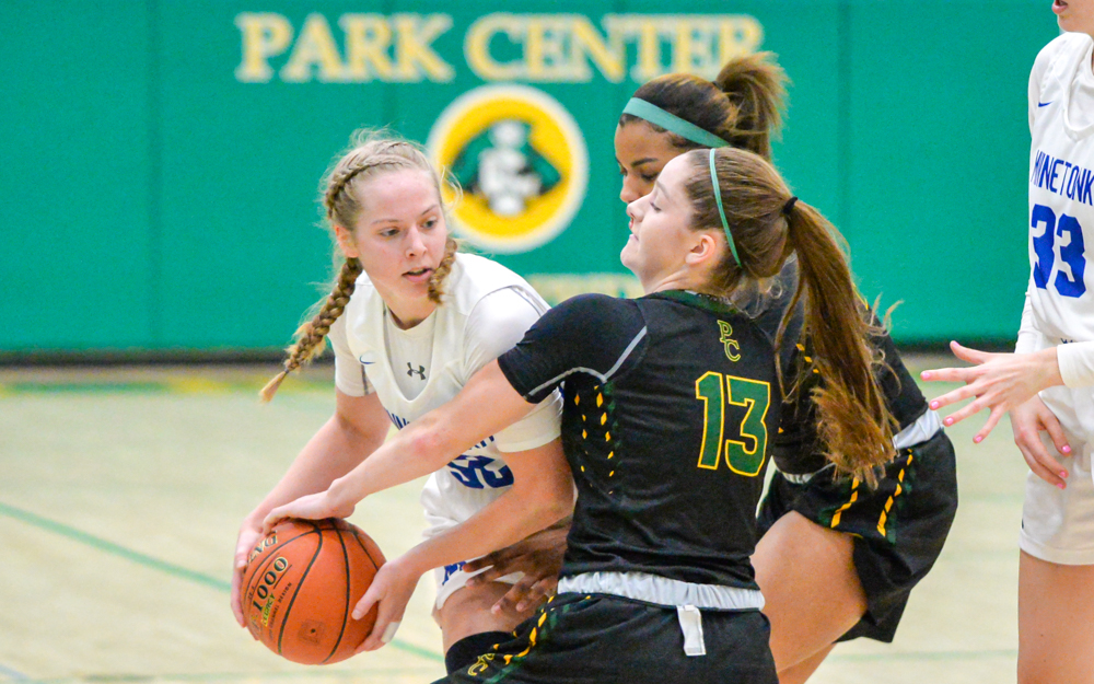 The Pirates' Lauren Frost (13) and her teammates played aggressive defense keeping Minnetonka to 58 points Friday night. Park Center defeated Minnetonka 75-58 at home in the Holiday Showcase. Photo by Earl J. Ebensteiner, SportsEngine