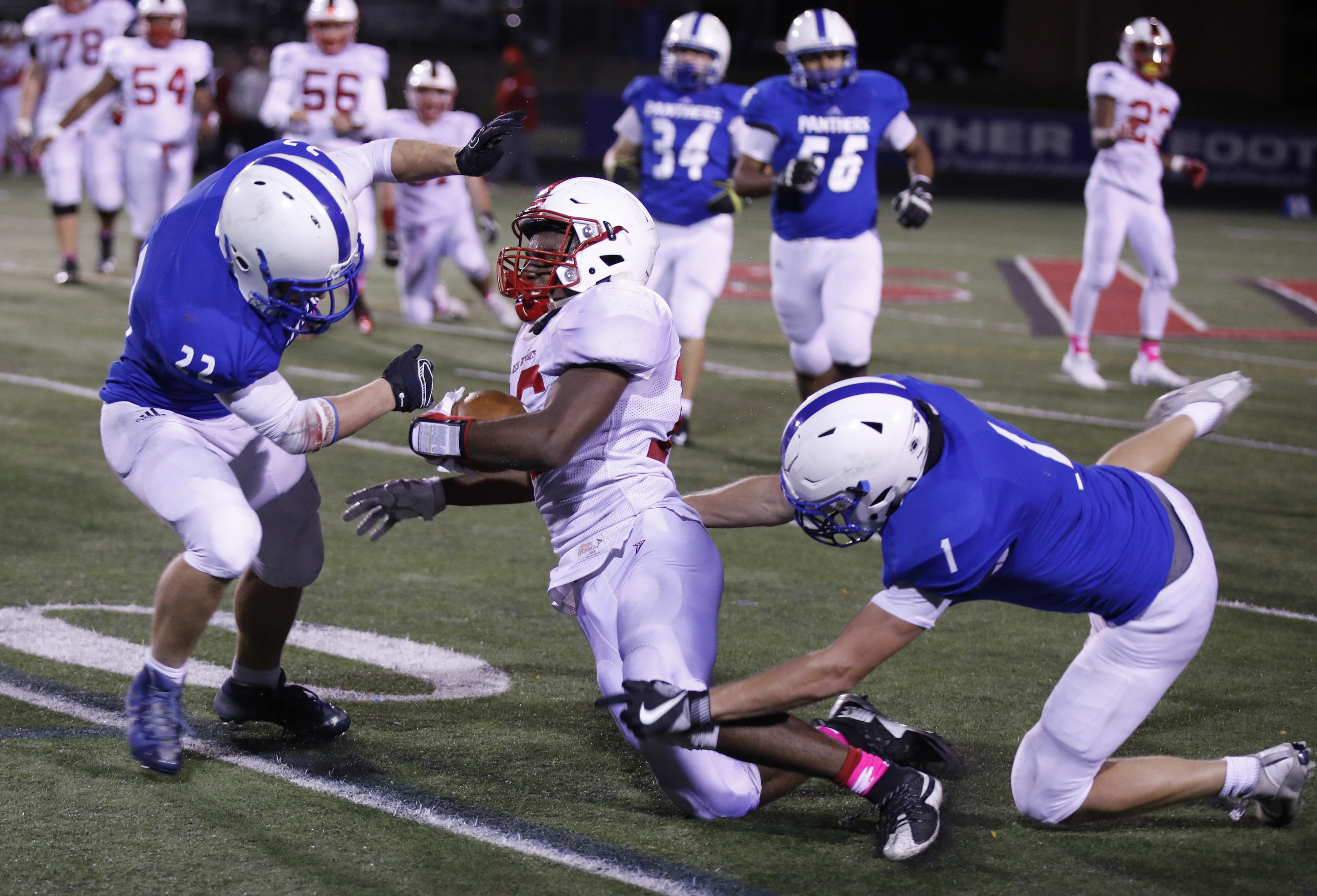 Ikenna Ujuagu (16) of Bernilde gets taken down by Nicholas Robinson (1) and Cade McMahon of Spring Lake Park. Spring Lake Park defeated Bernilde-St. Margaret's at home 19-13 in overtime from a tochdown from the senior QB, Zachary Ojile. Photo by Chris Juh